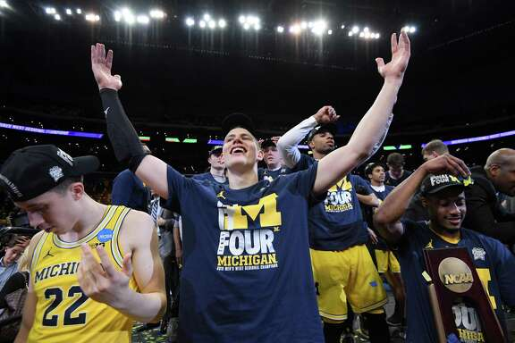 LOS ANGELES, CA - MARCH 24:  Moritz Wagner #13 of the Michigan Wolverines celebrates with the West Regional trophy after their 58-54 victory against the Florida State Seminoles in the 2018 NCAA Men's Basketball Tournament West Regional Final at Staples Center on March 24, 2018 in Los Angeles, California.  (Photo by Harry How/Getty Images) ***BESTPIX***