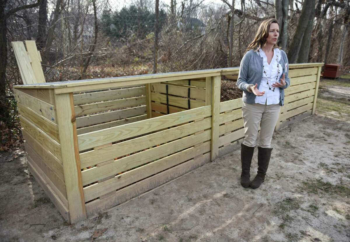 Greenwich Conservation Department Environmental Analyst Aleksandra Moch stands beside the compost bin behind Riverside School in Greenwich, Conn. in January 2016. Moch has spearheaded efforts to bring composting to all public schools in Greenwich and is now tackling the local high school.