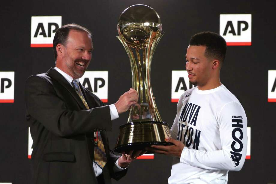 SAN ANTONIO, TX - MARCH 29:  Jalen Brunson #1 of the Villanova Wildcats is presented with the AP Player of the Year trophy by Barry Bedlan during media day for the 2018 Men's NCAA Final Four at the Alamodome on March 29, 2018 in San Antonio, Texas.  (Photo by Mike Lawrie/Getty Images) Photo: Mike Lawrie, Staff / Getty Images / 2018 Getty Images
