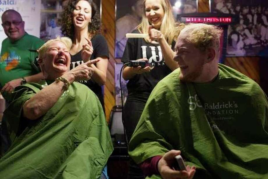 The Midland Firefighters Youth Foundation raises money and plenty of laughs during a previous 'brave the shave' event. (Daily News file photo)