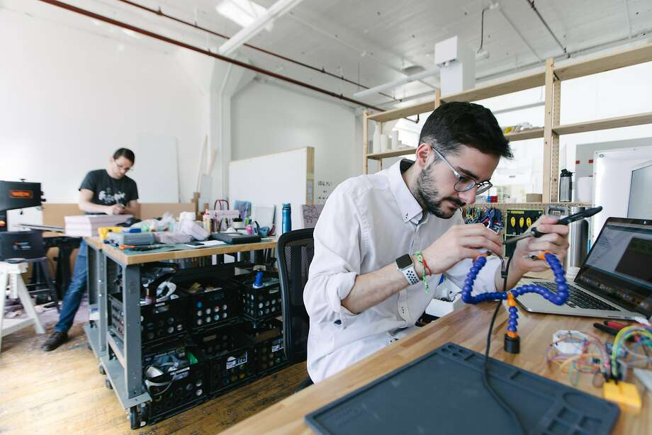 Alejandro Castillejo works on a prototype at Propelland, a design studio in San Francisco. He hopes an H-1B visa will let him stay in the United States so he can continue working at the company. The lottery for the visas begins Monday. Photo: Peter Prato / Special To The Chronicle