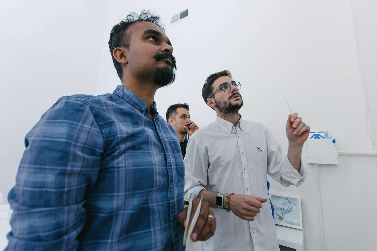 Siddharth Vanchinathan, left, Founding Partner and COO of Propelland, a Strategic Design Studio, engages with Alejandro Castillejo Mu�oz, right, in glasses, along with fellow co-workers in a critique at the design studio's offices in San Francisco on March 29th, 2018.