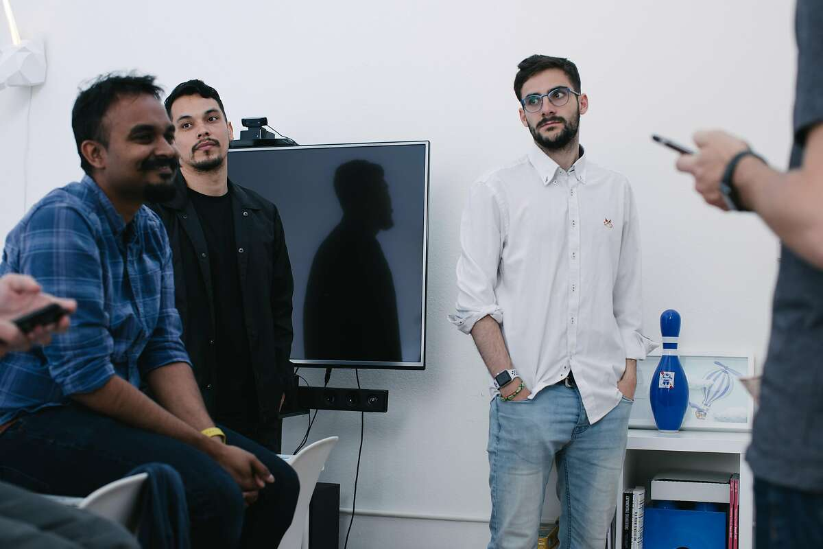 Alejandro Castillejo Mu�oz, right, in glasses, engages in a critique with fellow co-workers at the design firm where he works as a software engineer, Propelland, in San Francisco on March 29th, 2018.
