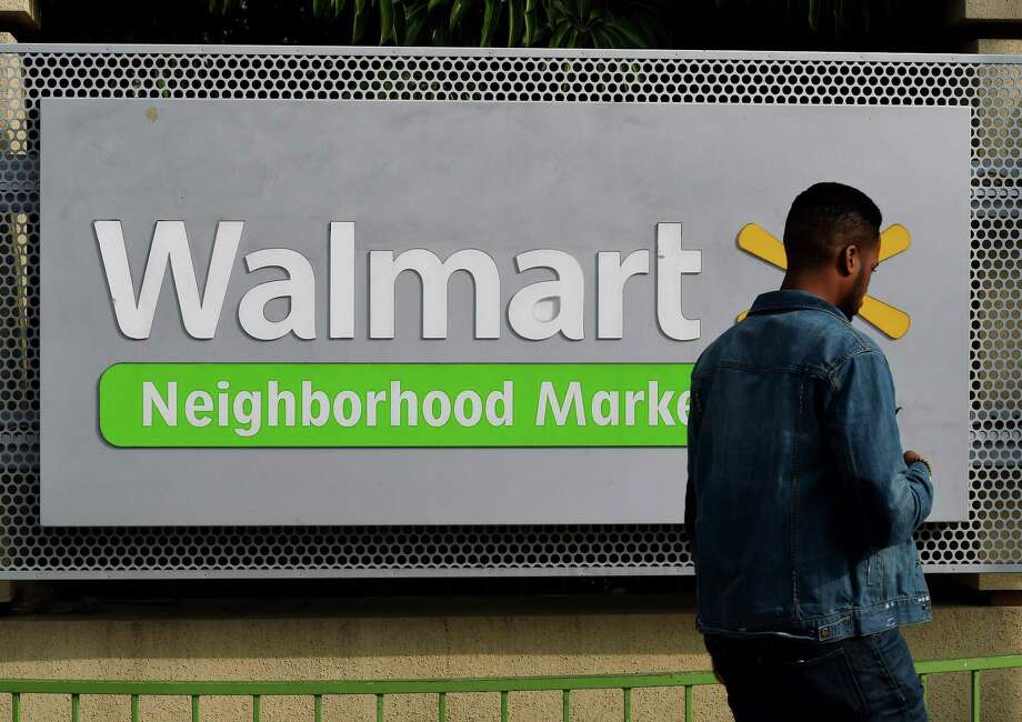 (FILES) This file photo taken on January 16, 2016 shows a manwalking past a Walmart store in Chinatown, Los Angeles. US retail behemoth Walmart is in preliminary talks to acquire health insurer Humana, the Wall Street Journal reported late on March 29, 2018. / AFP PHOTO / MARK RALSTONMARK RALSTON/AFP/Getty Images Photo: MARK RALSTON / AFP or licensors