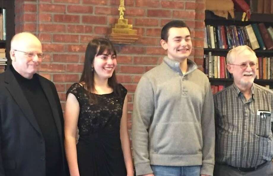 The Burnt Hills Oratorio Society hosted its annual vocal scholarship competition at Calvary Episcopal Church in Burnt Hills earlier this monthMarch that included seniors from area high schools. Of the nine applicants performing selections, Phoebe Reuther and runner-up Nicholas Contois, both from Shaker High School, won $1,000 and $750 scholarships respectively. Their music teachers are Dan Foster and Tyler Thomas. From left: society Music Director William Jon Gray, Reuther, Contois and retired music director Robert Reeves, an adjudicator.