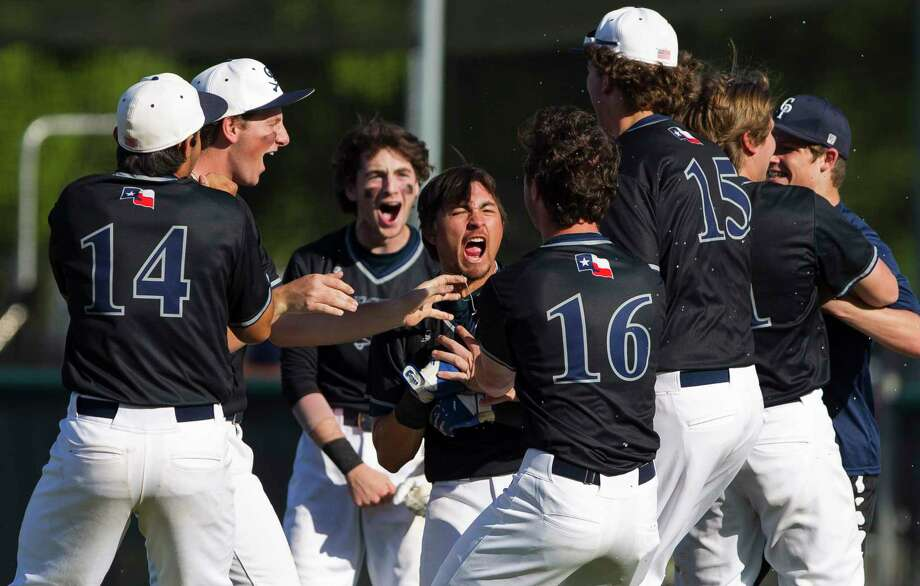 College Park's Isaac Rivera celebrates with teammates after hitting a walk-off single to score Luke Repka and defeat Lufkin 4-3 during the seventh inning of a District 12-6A high school baseball game, Friday, March 30, 2018, in The Woodlands. Photo: Jason Fochtman, Staff Photographer / © 2018 Houston Chronicle