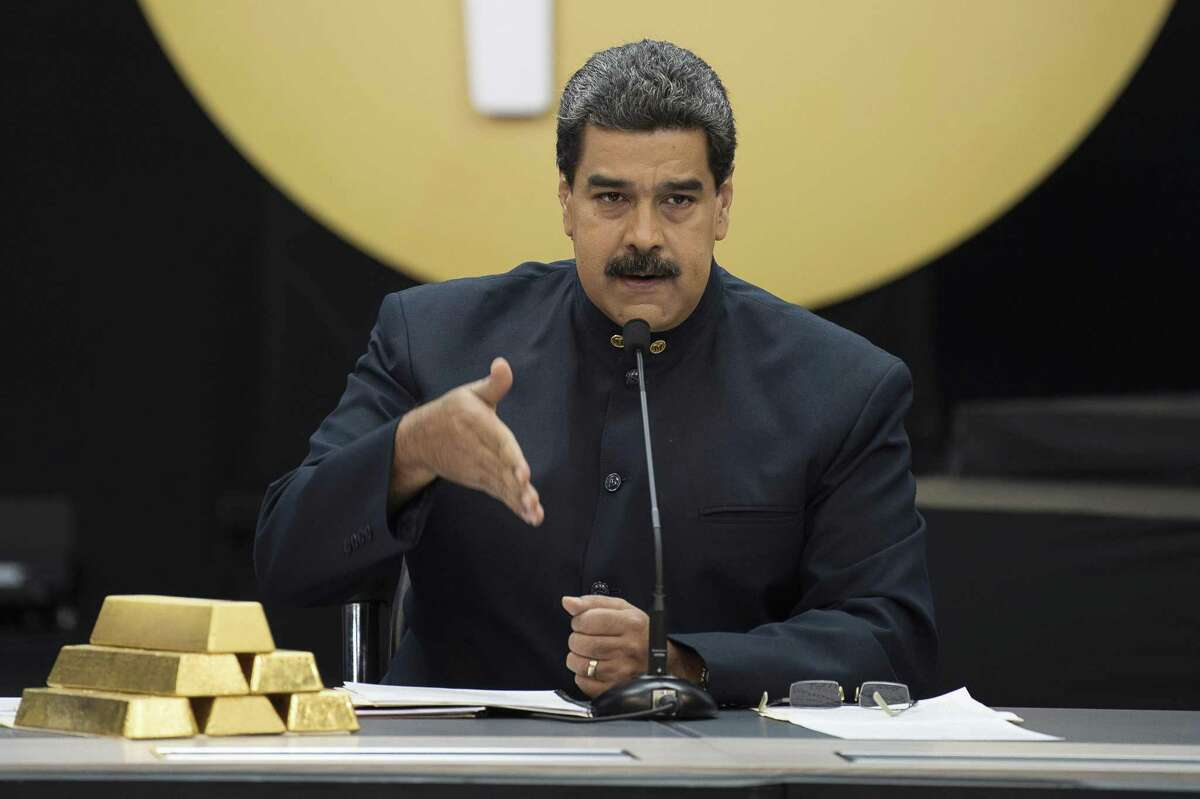 Nicolas Maduro, Venezuela's president, speaks next to a stack of 12 Kilogram gold ingots during a news conference on the country's cryptocurrency, known as thePetro, in Caracas, Venezuela, on Thursday, March 22, 2018. U.S. President Trump banned U.S. purchases of the Petro as part of a campaign to pressure the government of Maduro. Photographer: Carlos Becerra/Bloomberg