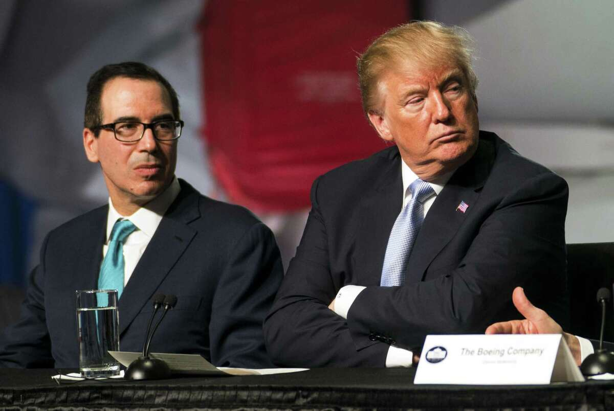 President Donald Trump with Treasury Secretary Steve Mnuchin during a roundtable discussion on tax cuts in St. Louis, Mo., on March 14, 2018. The Trump administration on Monday, March 19, announced it was broadening sanctions against Venezuela, blacklisting four government officials and banning a digital currency President Nicolás Maduro created last month to circumvent financial sanctions on his economically strapped nation. (Doug Mills/The New York Times)