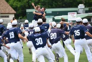 Staples pitcher Chad Knight, rear right, and catcher Matt Stone, rear left, leap and embrace as the rest of their teammates rush to them after the final out of Saturday's Class LL championship game against Amity. Staples won 5-1. 6-10-17