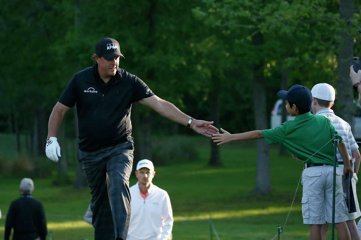 Phil Mickelson greets a fan on the way to the 11th tee during the second round of the Houston Open at the Golf Club of Houston on March 30, 2018.