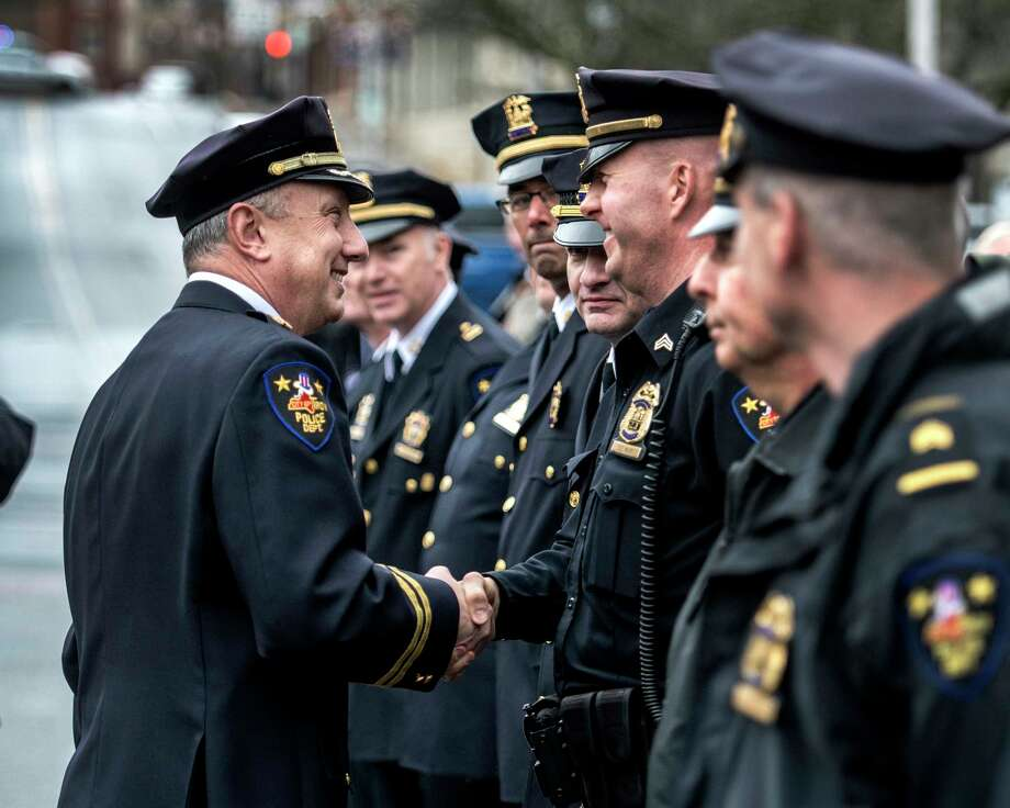 Assistant Chief of Department George VanBramer is given good wishes from his command at his retirement ceremony Friday March 30, 2018 outside of police headquarters in Troy, N.Y.  (Skip Dickstein/Times Union) Photo: SKIP DICKSTEIN / 20043331A