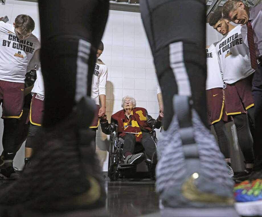 Sister Jean Dolores-Schmidt prays with the Loyola-Chicago Ramblers before their South Regional final against Kansas State at Philips Arena in Atlanta. The nun, 95, was raised in Eureka Valley, now the Castro. Photo: John J. Kim / TNS / Chicago Tribune / Chicago Tribune