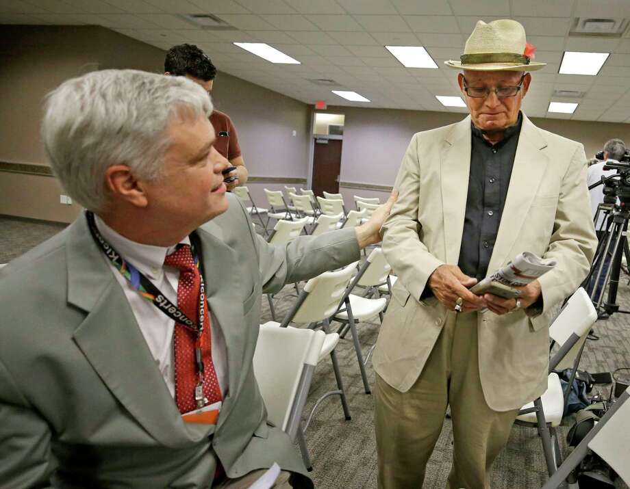 Dr. Philip Keiser, Galveston County Local Health Authority, left, talks with Henry Gomez, who is concerned about the health of young family members, after a news conference about an investigation of procedures performed at Coastal Health and Wellness with unsterilized equipment that may have put patients at risk for hepatitis and HIV shown Friday, March 30, 2018, in Texas City. Photo: Melissa Phillip, Houston Chronicle / © 2018 Houston Chronicle
