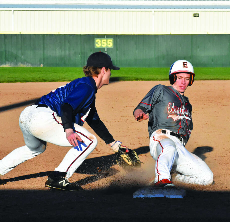 Edwardsville's Aaron Young, right, slides safely into third base during the fifth inning against Parkway South.