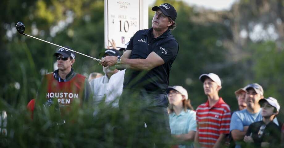 Phil Mickelson plays his shot from the tenth tee during the second round of the Houston Open at the Golf Club of Houston on Friday, March 30, 2018. (Tim Warner /Houston Chronicle via AP) Photo: Tim Warner/Associated Press