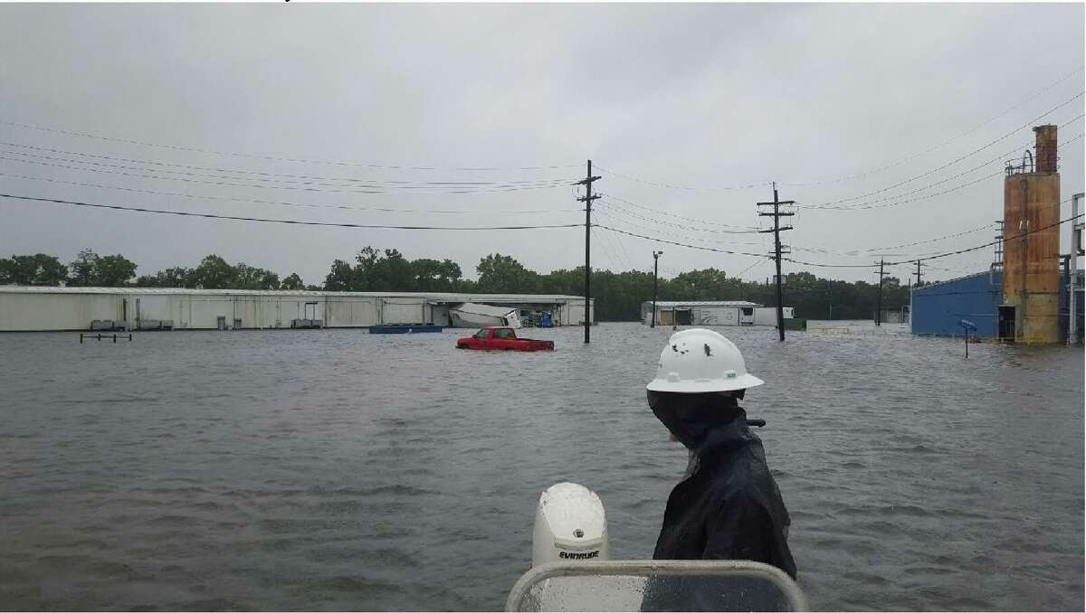 Arkema's Hurricane Harvey ride out crew take one last look of the flooded facility as they evacuate the Crosby site on Aug. 29, 2017.