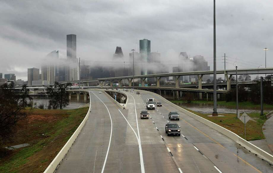 The downtown skyline shrouded in mist after overnight storms dumped several inches of rain as motorists head north on Interstate 45 near Quitman on Feb. 10, 2018, in Houston. Photo: Karen Warren, Staff / Houston Chronicle / © 2018 Houston Chronicle