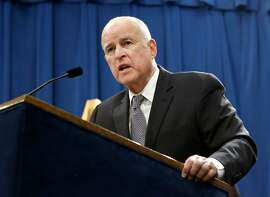 FILE - In this Jan. 10, 2018 file photo, California Gov. Jerry Brown responds to a question at a news conference in Sacramento, Calif. Gov. Brown on Friday, March 30, pardoned five ex-convicts facing deportation, including two whose families fled the Khmer Rouge regime in Cambodia four decades ago. (AP Photo/Rich Pedroncelli, File)