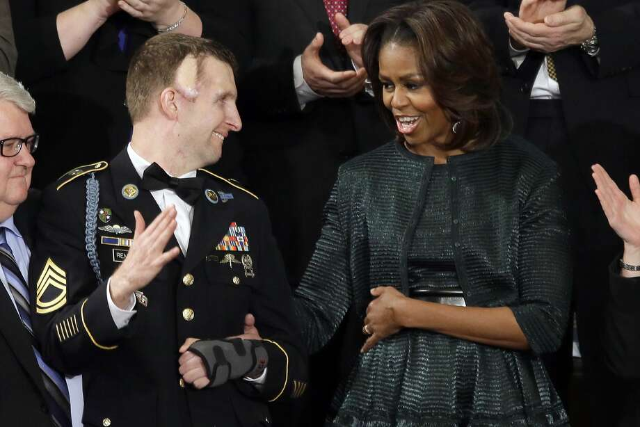 Michelle Obama talks with Army Ranger Sgt. 1st Class Cory Remsburg during President Barack Obama's State of the Union address in January 2014. Photo: J. Scott Applewhite / AP