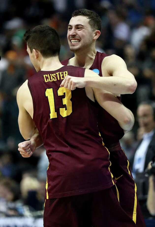 DALLAS, TX - MARCH 15:  Clayton Custer #13 and Ben Richardson #14 celebrate after Donte Ingram #0 of the Loyola Ramblers  makes his game-winning three pointer against the Miami Hurricanes in the first round of the 2018 NCAA Men's Basketball Tournament at American Airlines Center on March 15, 2018 in Dallas, Texas.  (Photo by Ronald Martinez/Getty Images) Photo: Ronald Martinez / 2018 Getty Images