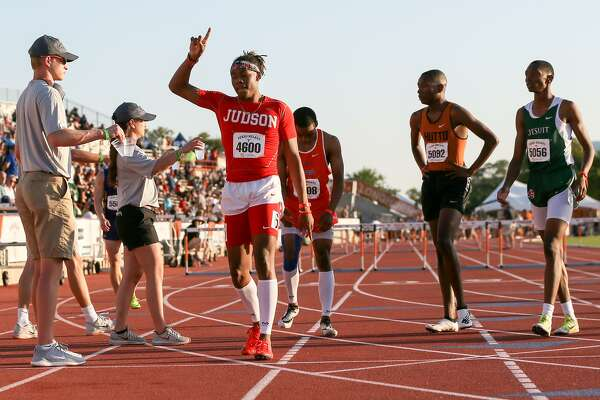 Judson's Tre'Bien Gilbert (4600) celebrates after winning the second heat of the high school boys 300-meter hurdles during the Clyde Littlefield Texas Relays at Mike A. Myers Stadium in Austin on Friday, March 30, 2018.  Gilbert won the event with a time of 36.87 seconds.  MARVIN PFEIFFER/mpfeiffer@express-news.net