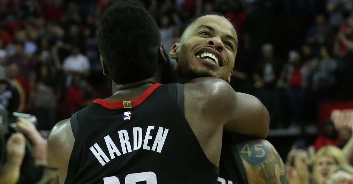 Houston Rockets guard James Harden (13) congratulates Gerald Green (14) for his buzzer beater in the fourth quarter of the NBA game against the Phoenix Suns helps the team to win at Toyota Center on Friday, March 30, 2018, in Houston. The Houston Rockets defeated the Phoenix Suns 104-103 the last second of the game.( Yi-Chin Lee / Houston Chronicle )