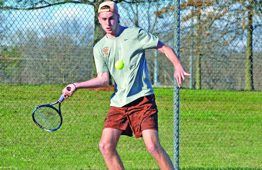 Edwardsville senior Alex Gray hits a forehand shot during a match on Friday.