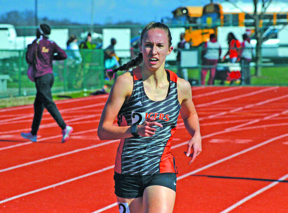 Melissa Spencer runs to a victory in the 1,600-meter run at Belleville West.