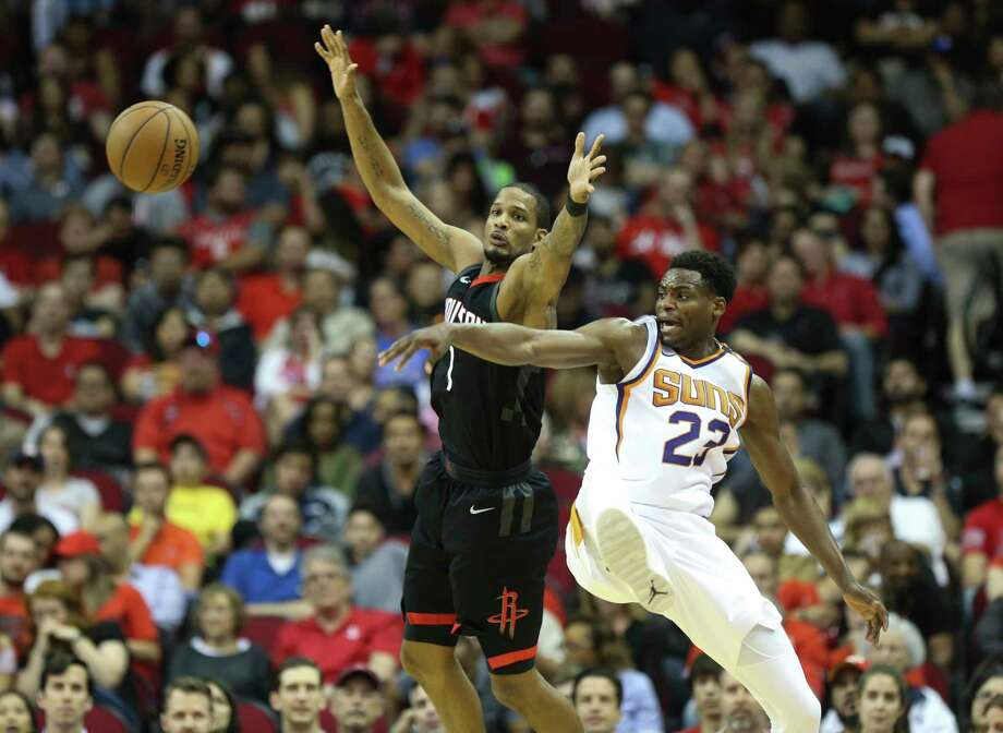 Phoenix Suns forward Danuel House Jr. (23) interrupts a pass to Houston Rockets forward Trevor Ariza (1) during the second quarter of the NBA game at Toyota Center on Friday, March 30, 2018, in Houston. ( Yi-Chin Lee / Houston Chronicle ) Photo: Yi-Chin Lee / © 2018 Houston Chronicle