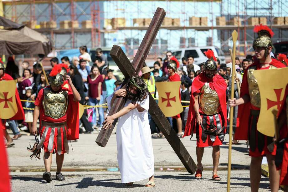 Melvin Narrate, of the Amgio Cristo youth group, surrounded by Roman guards and spectators, performs as Jesus Christ during the live Stations of the Cross ceremony on Friday, March 30, 2018, at Sacred Heart Catholic Church in Conroe. Photo: Michael Minasi, Staff Photographer / © 2018 Houston Chronicle