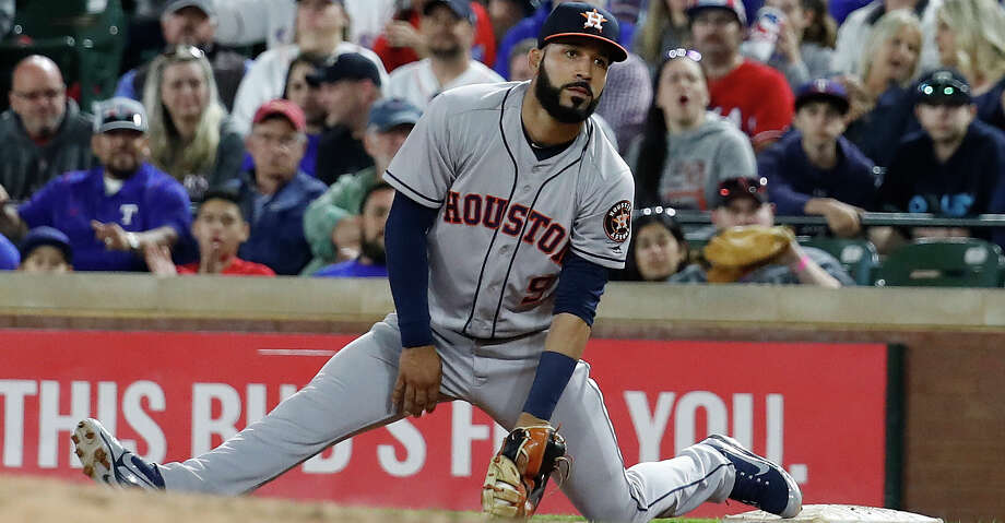 Houston Astros first baseman Marwin Gonzalez (9) goes into splits trying to catch Texas Rangers Elvis Andrus' single in the fifth inning of an MLB baseball game Globe Life Park, Friday, March 30, 2018, in Arlington.   ( Karen Warren / Houston Chronicle ) Photo: Karen Warren/Houston Chronicle