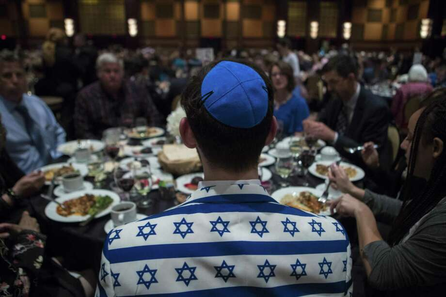 A man showing Jewish pride joins the massive Congregation Beth Messiah Synagogue Passover dinner at the Hilton Americas-Houston, Friday, March 30, 2018, in Houston. Photo: Marie D. De Jesus, Houston Chronicle / Houston Chronicle / © 2018 Houston Chronicle