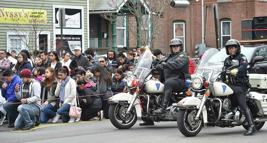 Images of the parishioners at Our Lady of Guadalupe Parish processing through the streets of Fair Haven for the Stations of the Cross on Good Friday, March 30, 2018. Photo: Catherine Avalone, Hearst Connecticut Media / New Haven Register