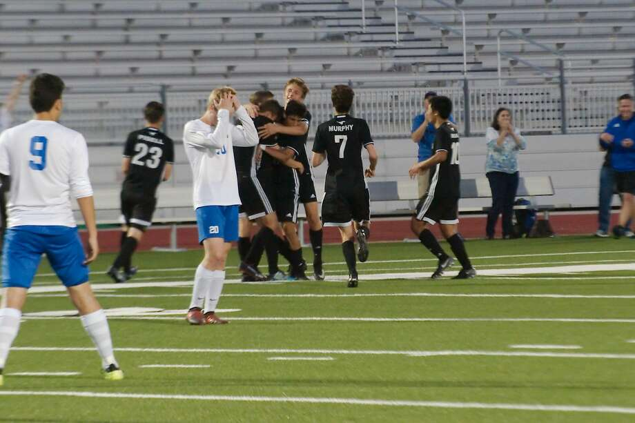Friendswood's Zach Montz (13) is congratulated by teammates after scoring a goal against Brazoswood  Thursday, Mar. 29 at CCISD Challenger Columbia Stadium. Photo: Kirk Sides / Houston Chronicle