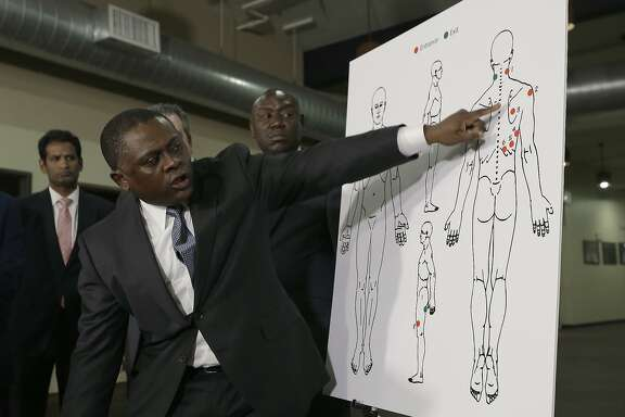 Pathologist Dr. Bennet Omalu points to details in a diagram showing the gunshot wounds he found on the body of Stephon Clark who was shot by Sacramento police, during a news conference Friday, March 30, 2018, in Sacramento, Calif. Omalu was hired by the attorneys of the Clark family to perform the independent autopsy. (AP Photo/Rich Pedroncelli)
