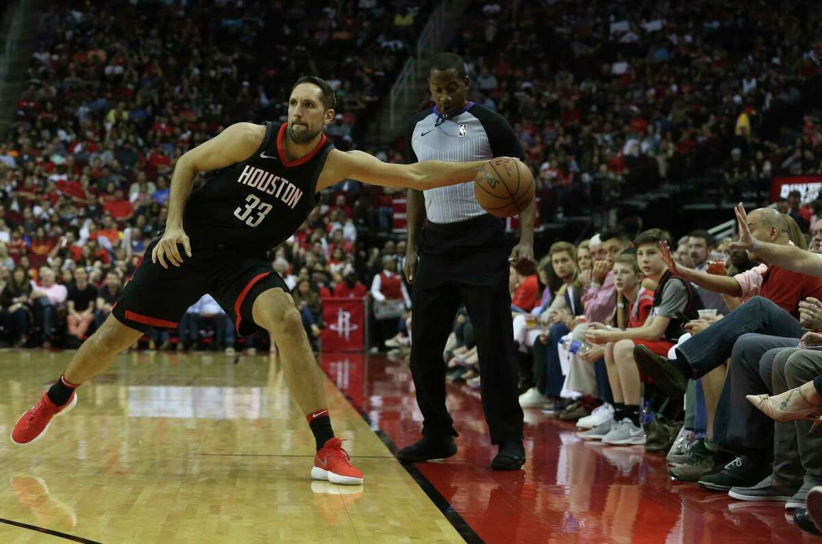 Houston Rockets forward Ryan Anderson (33) grabs a ball that is almost out-of-bounce during the third quarter of the NBA game against the Phoenix Suns at Toyota Center on Friday, March 30, 2018, in Houston. The Houston Rockets defeated the Phoenix Suns 104-103 the last second of the game.