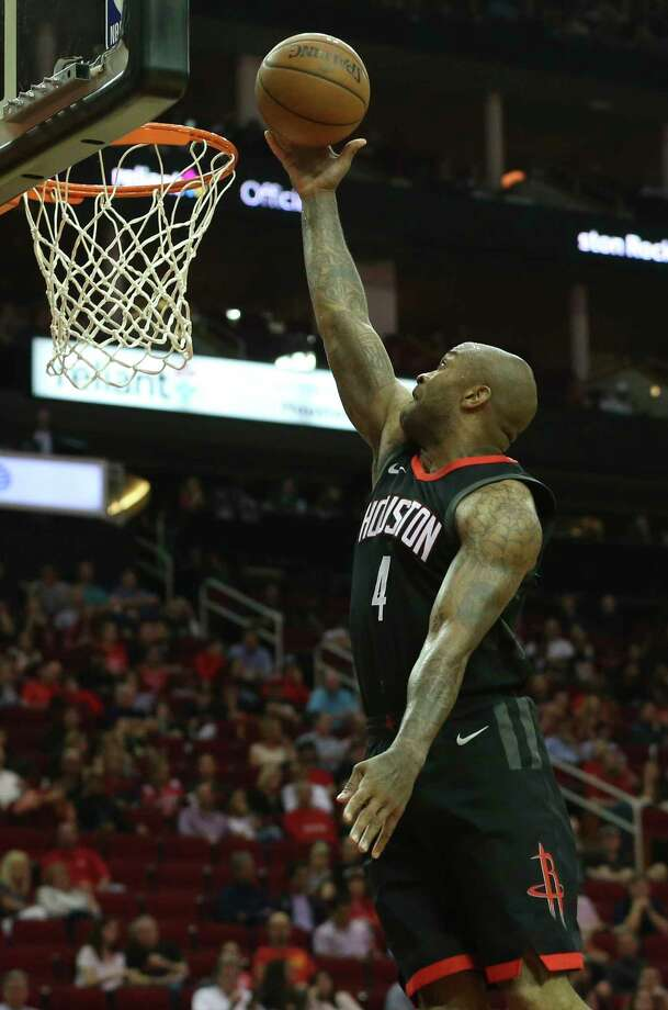 Houston Rockets forward PJ Tucker (4) puts the ball into the basket during the third quarter of the NBA game against the Phoenix Suns at Toyota Center on Friday, March 30, 2018, in Houston. The Houston Rockets defeated the Phoenix Suns 104-103 the last second of the game. Photo: Yi-Chin Lee, Houston Chronicle / © 2018 Houston Chronicle