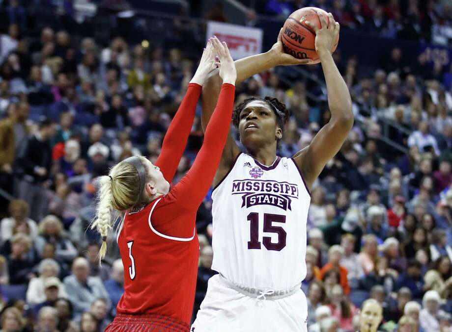 COLUMBUS, OH - MARCH 30: Teaira McCowan #15 of the Mississippi State Lady Bulldogs is defended by Sam Fuehring #3 of the Louisville Cardinals during the first half in the semifinals of the 2018 NCAA Women's Final Four at Nationwide Arena on March 30, 2018 in Columbus, Ohio.  (Photo by Andy Lyons/Getty Images) Photo: Andy Lyons / 2018 Getty Images