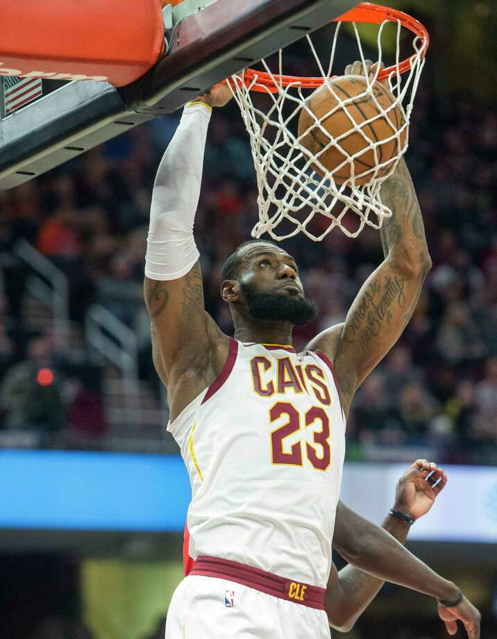 Cleveland Cavaliers' LeBron James dunks against the New Orleans Pelicans during the first half of an NBA basketball game in Cleveland, Friday, March 30, 2018. (AP Photo/Phil Long) Photo: Phil Long / FR53611 AP