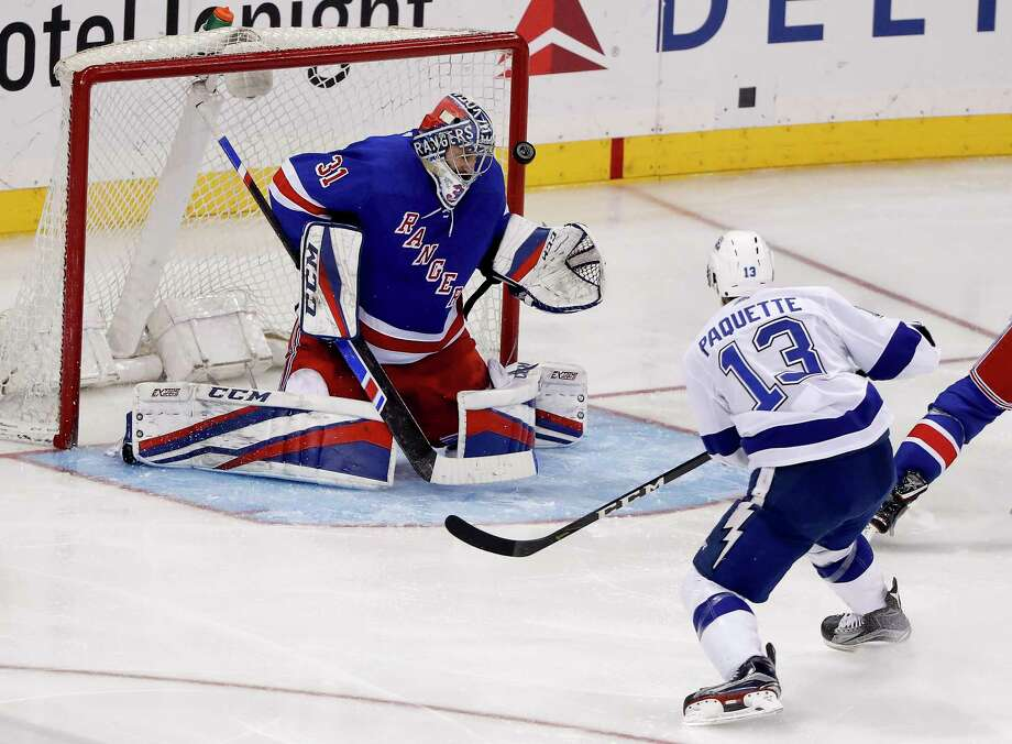 Tampa Bay Lightning center Cedric Paquette (13) scores a goal against New York Rangers goaltender Ondrej Pavelec (31) during the third period of an NHL hockey game, Friday, March 30, 2018, in New York. (AP Photo/Julie Jacobson) Photo: Julie Jacobson / Copyright 2018 The Associated Press. All rights reserved.