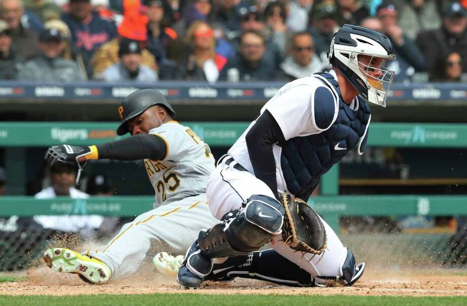 Pittsburgh Pirates' Gregory Polanco beats the throw to Detroit Tigers catcher James McCann to score on an RBI single by teammate Corey Dickerson during the fourth inning of a baseball game, Friday, March 30, 2018, in Detroit. (AP Photo/Carlos Osorio) Photo: Carlos Osorio / Copyright 2018 The Associated Press. All rights reserved.