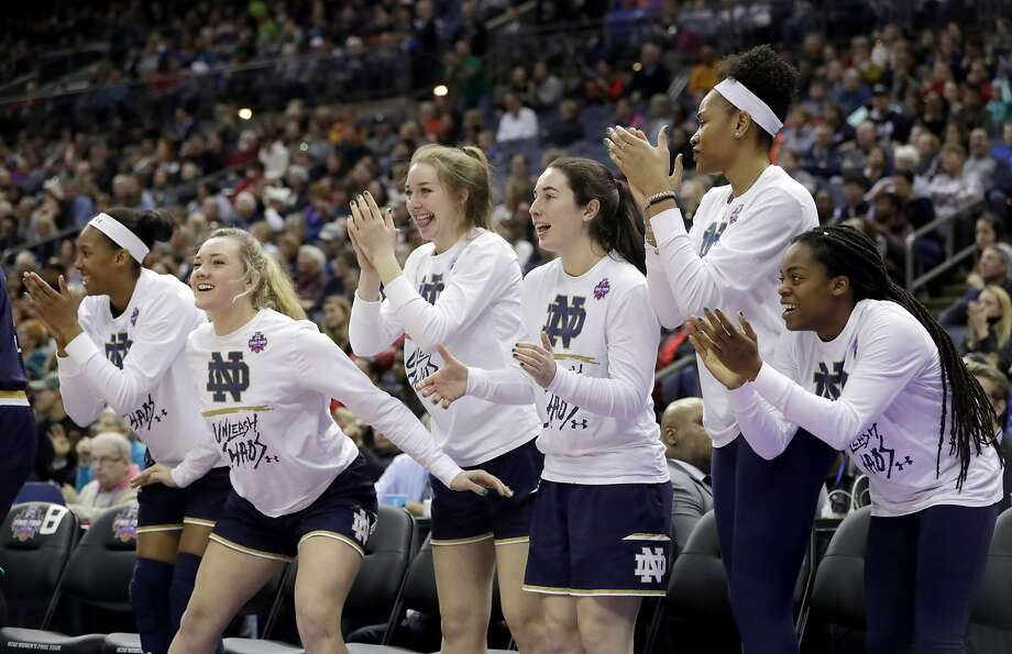 The Notre Dame bench celebrates during the second half against Connecticut in the semifinals of the women's NCAA Final Four college basketball tournament, Friday, March 30, 2018, in Columbus, Ohio. (AP Photo/Tony Dejak) Photo: Tony Dejak, Associated Press
