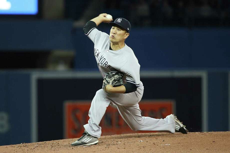 TORONTO, ON - MARCH 30: Masahiro Tanaka #19 of the New York Yankees delivers a pitch in the third inning on Opening Day during MLB game action against the Toronto Blue Jays at Rogers Centre on March 30, 2018 in Toronto, Canada. (Photo by Tom Szczerbowski/Getty Images) Photo: Tom Szczerbowski / 2018 Getty Images
