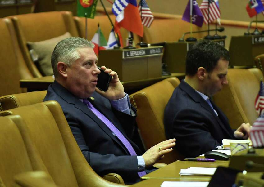 Assemblyman John T. McDonald III speaks on the phone while seated in the Assembly Chamber on Friday morning, March 30, 2018, at the Capitol in Albany, N.Y. (Will Waldron/Times Union)