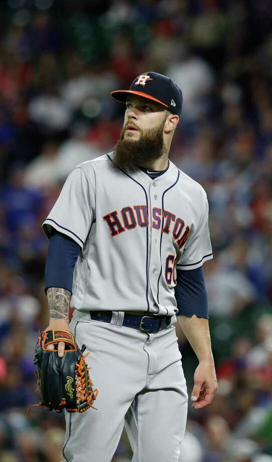 Houston Astros starting pitcher Dallas Keuchel (60) reacts after giving up a run to Texas Rangers Nomar Mazara in the fourth inning of an MLB baseball game Globe Life Park, Friday, March 30, 2018, in Arlington. Photo: Karen Warren, Houston Chronicle / © 2018 Houston Chronicle
