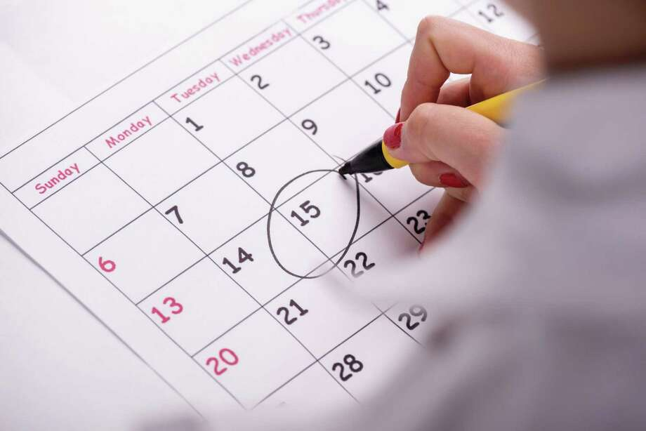 Close-up top-view photo of calendar with a datum circled by young woman with red nails with a back marker, concept of time management at work / zinkevych - Fotolia