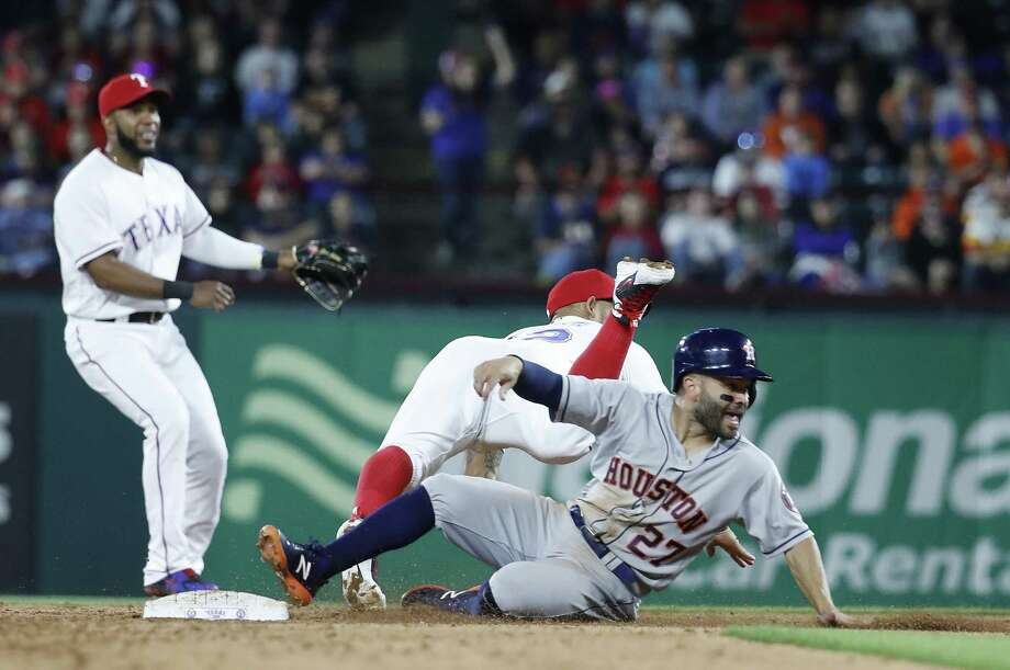 The Astros' Jose Altuve, right, collides with the Rangers' Rougned Odor at second base during the six inning Friday night at Globe Life Park. Photo: Karen Warren, Staff / Houston Chronicle / © 2018 Houston Chronicle