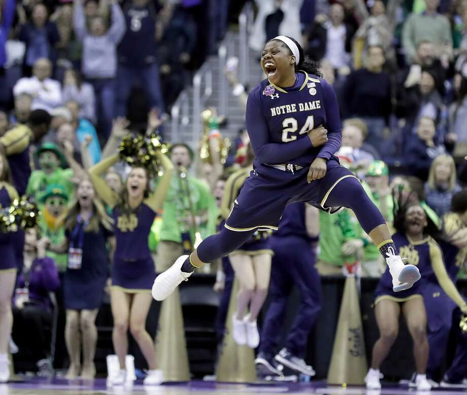 183f3144e526 Notre Dame s Arike Ogunbowale celebrates after making the game-winning  basket during overtime against Connecticut