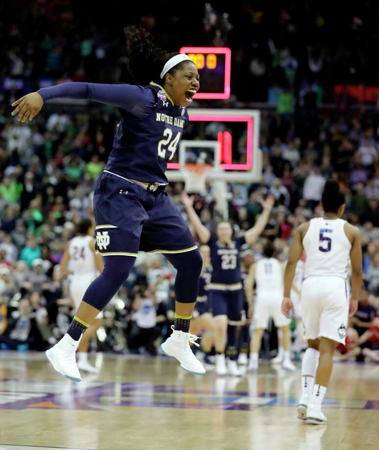 Notre Dame's Arike Ogunbowale (24) celebrates as Connecticut's Crystal Dangerfield (5) walks away as time expires in overtime in the semifinals of the women's NCAA Final Four college basketball tournament, Friday, March 30, 2018, in Columbus, Ohio. Notre Dame won 91-89. (AP Photo/Tony Dejak) Photo: Tony Dejak / Copyright 2018 The Associated Press. All rights reserved.