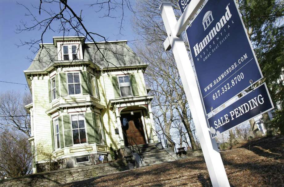 A sale is pending for this home in Newton, Mass. The National Association of Realtors says pending U.S. home sales rose in February after a plunge a month earlier. Photo: Bill Sikes, STF / AP / AP